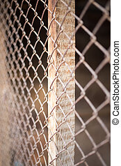 a fence of rusty metal mesh