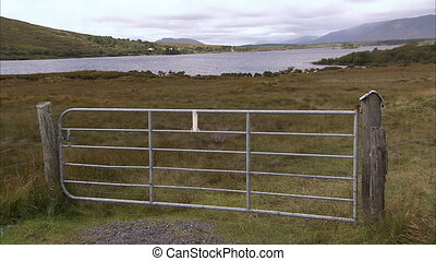 A fence on a landscape - A scenic wide shot of a fence on a...