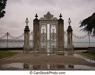 A fence with high columns and gate in the palace garden
