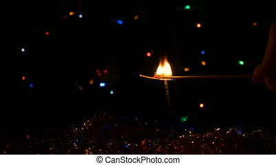 A festive fire lights match.