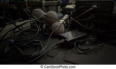 few microphones in sound studio with wires