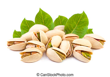 A few Pistachio nuts with leaves on white background