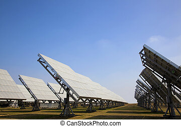 A field of photovoltaic solar panels providing green energy