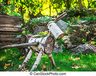 a figure of wood logs in the garden