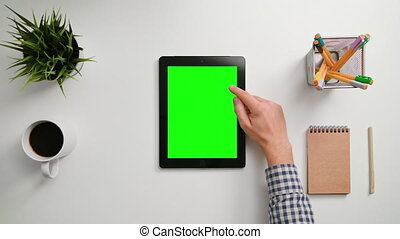 A Finger Scrolling on the Green Touchscreen