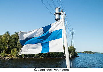 A finnish flag on a boat in the wind and high voltage line on lake Saimaa near the Lappeenranta, Finland