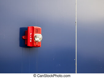 A fire alarm with built in strobe light to alert in case of fire