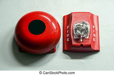 A fire alarm with built in strobe light to alert in case of fire.