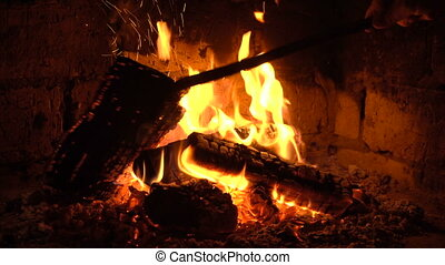 A fire burns in a fireplace, Fire to keep warm