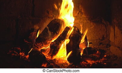 A fire burns in a fireplace, Fire to keep warm.