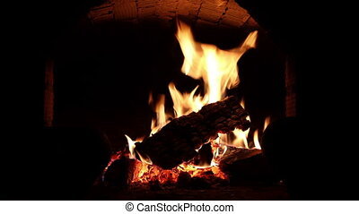 A fire burns in a fireplace - Wood burning with orange fire...