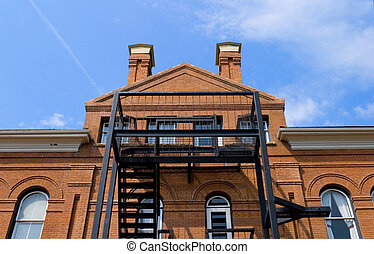 A fire escape on an old brick building