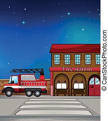 A fire truck near the fire station