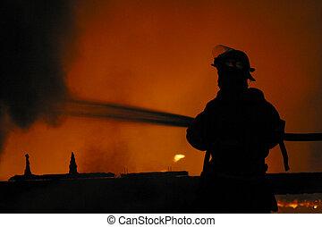 firefighter - A firefighter at a blaze.