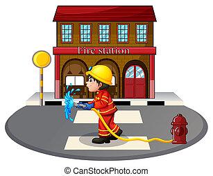 A fireman holding a fire hose near a hydrant