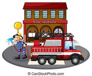 A fireman holding a hose near a firetruck