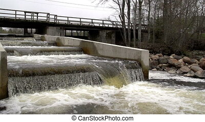 A fish ladder under the bridge - A fish ladder with rushing...