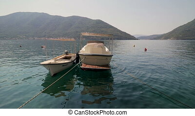 A fishing boat is moored on the water