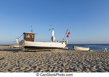 A fishing boat on shore of the Baltic Sea in Koserow, Germany.