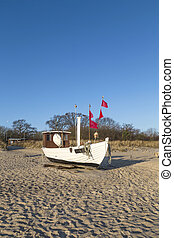 fishing boat on shore of the Baltic Sea in Koserow, Germany.