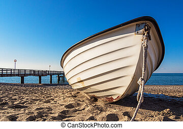 A fishing boat on shore of the Baltic Sea in Rerik (Germany).