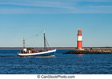 A fishing boat on the mole in Warnemuende, Germany