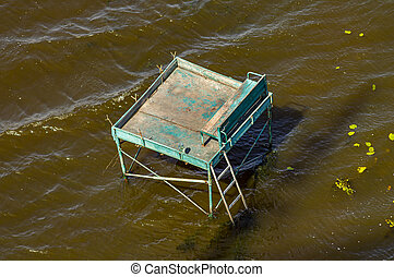 A fishing platform for fishing in the water.