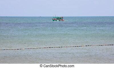 fishing ship sails on the sea shore - a fishing ship sails...