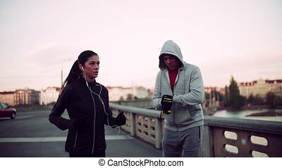 A fit couple runners doing exercise outdoors on the bridge...