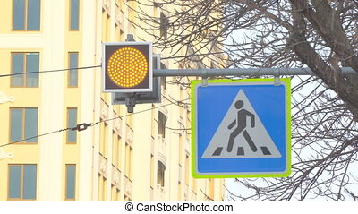A flashing yellow light on pedestrian crossing - A flashing...