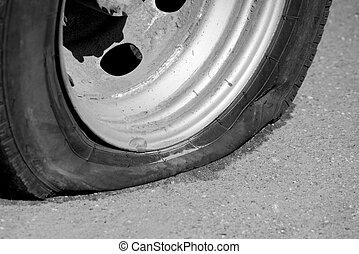 A flat tire of car