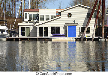 A floating house with a blue door, Portland OR.