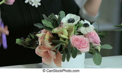 a florist make wedding bouquet in white box