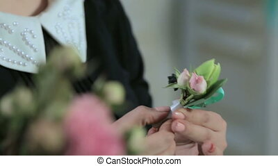a florist show a little bouquet in hand