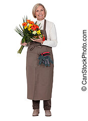 a florist with a flowers bouquet
