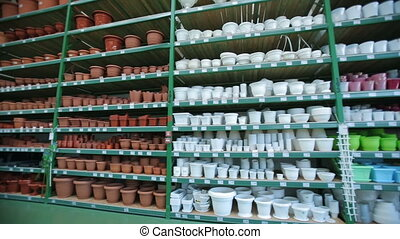 A flower pots at store - Ceramic and plastic flower pots at...