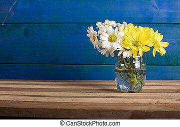 A flower vase in blue background