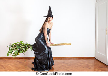 a flying witch - beautiful witch tries out her new eco broom