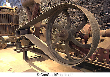 A flywheel - An old rusty flywheel in a cellar