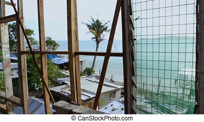 A focused shot of a sea side cottage in Papua new guinea -...