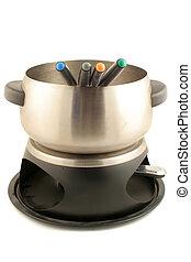 fondue set - a fondue set with dipping sticks on a white ...