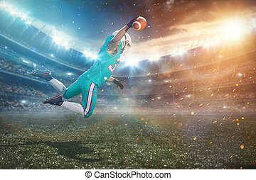 A football player leaping off the ground, to catch the ball near the goal posts.
