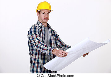 A foreman checking his plans.