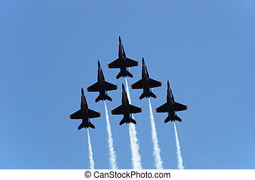 formation - a formation of airplanes on a blue sky