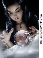 A fortune teller gazes into her crystal ball
