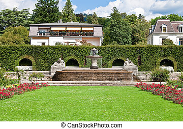 A fountain in the park of roses. Germany, Baden-Baden.