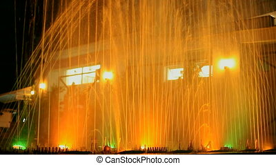 A fountain with an orange backlight