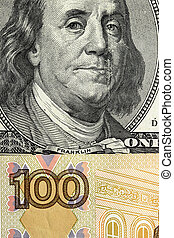 A fragment of one hundred dollars and one hundred rubles