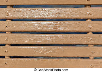 Painted wooden boards, horizontal brown line. A fragment of the wooden backless benches