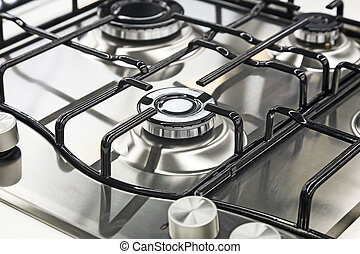 A fragment of the cooktop of the gas stove. - A fragment of...